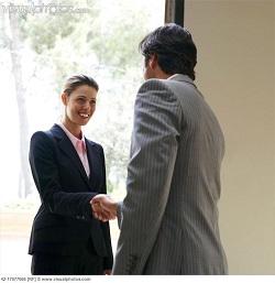 Businesspeople Shaking Hands In Doorway 42 17077066 1